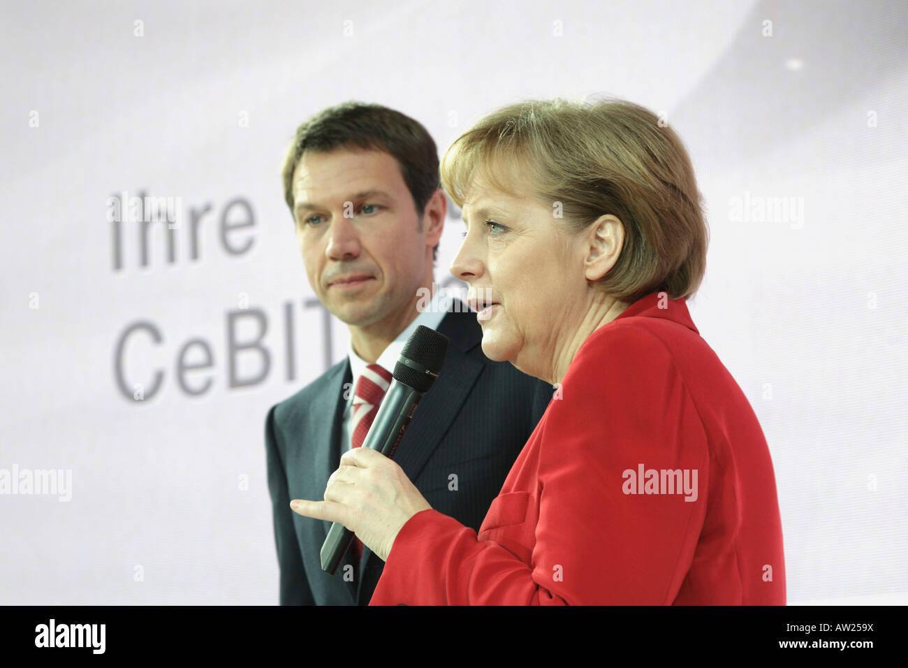 CeBIT 2008 - German chancellor Angela Merkel stands next to Deutsche Telekom CEO Rene Obermann Stock Photo