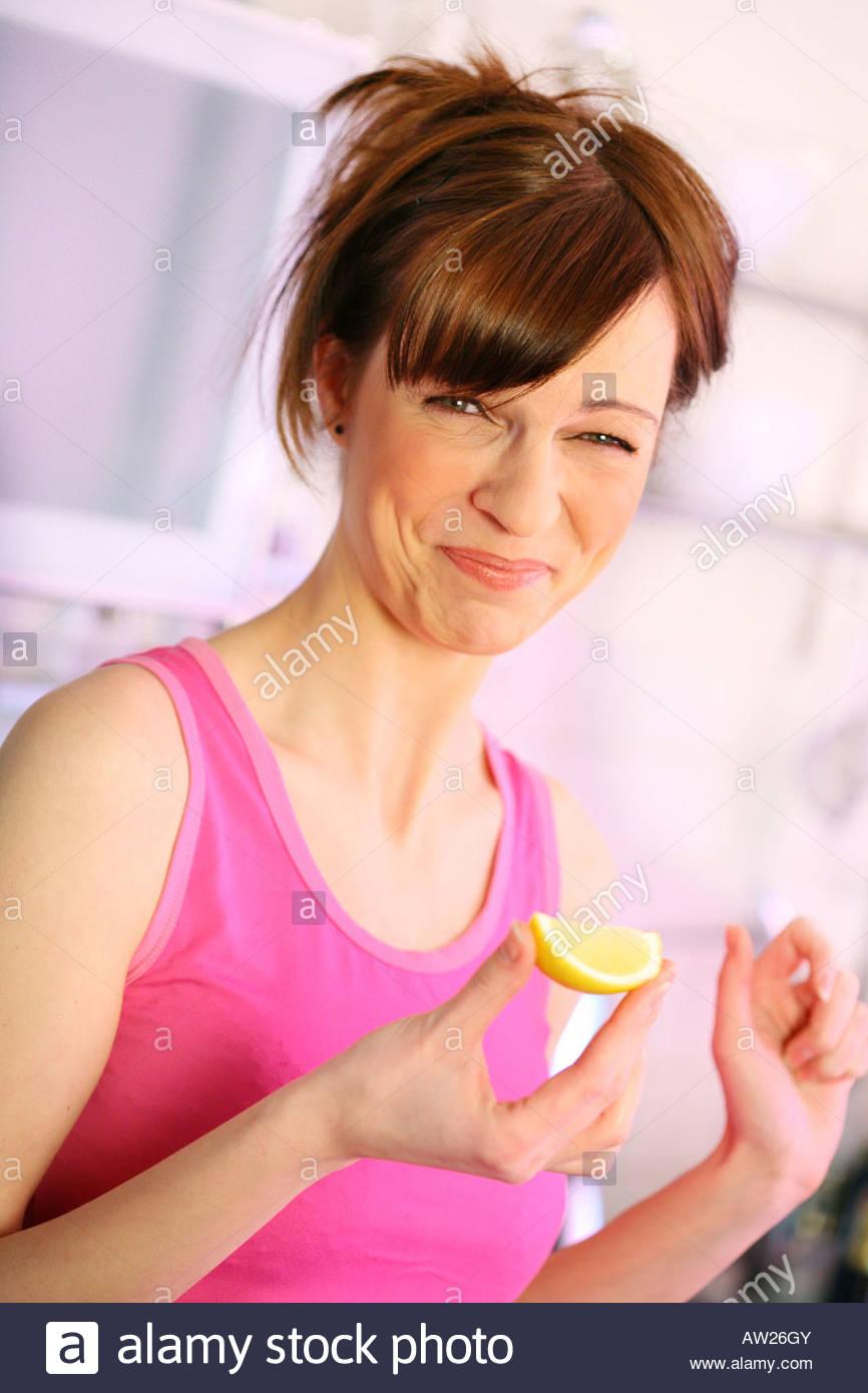 woman biting a lemon Stock Photo
