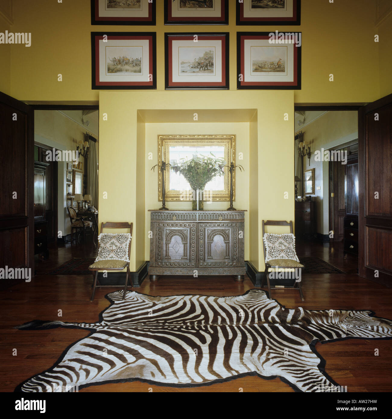 zebra skin floor covering in the entrance lobby of a Zimbabwean farmhouse - Stock Image