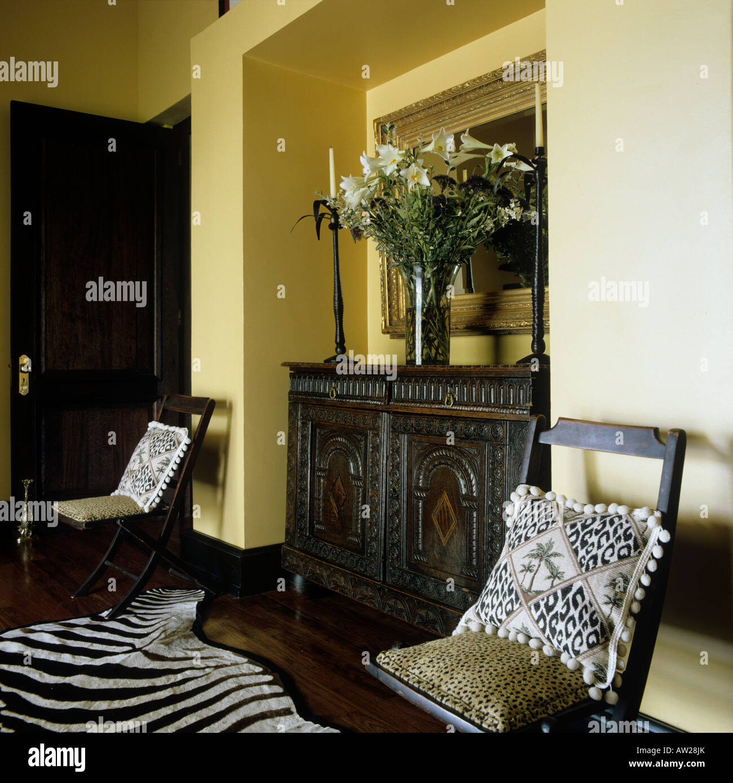 entrance lobby of a Zimbabwean farmhouse with zebra skin on the floor - Stock Image