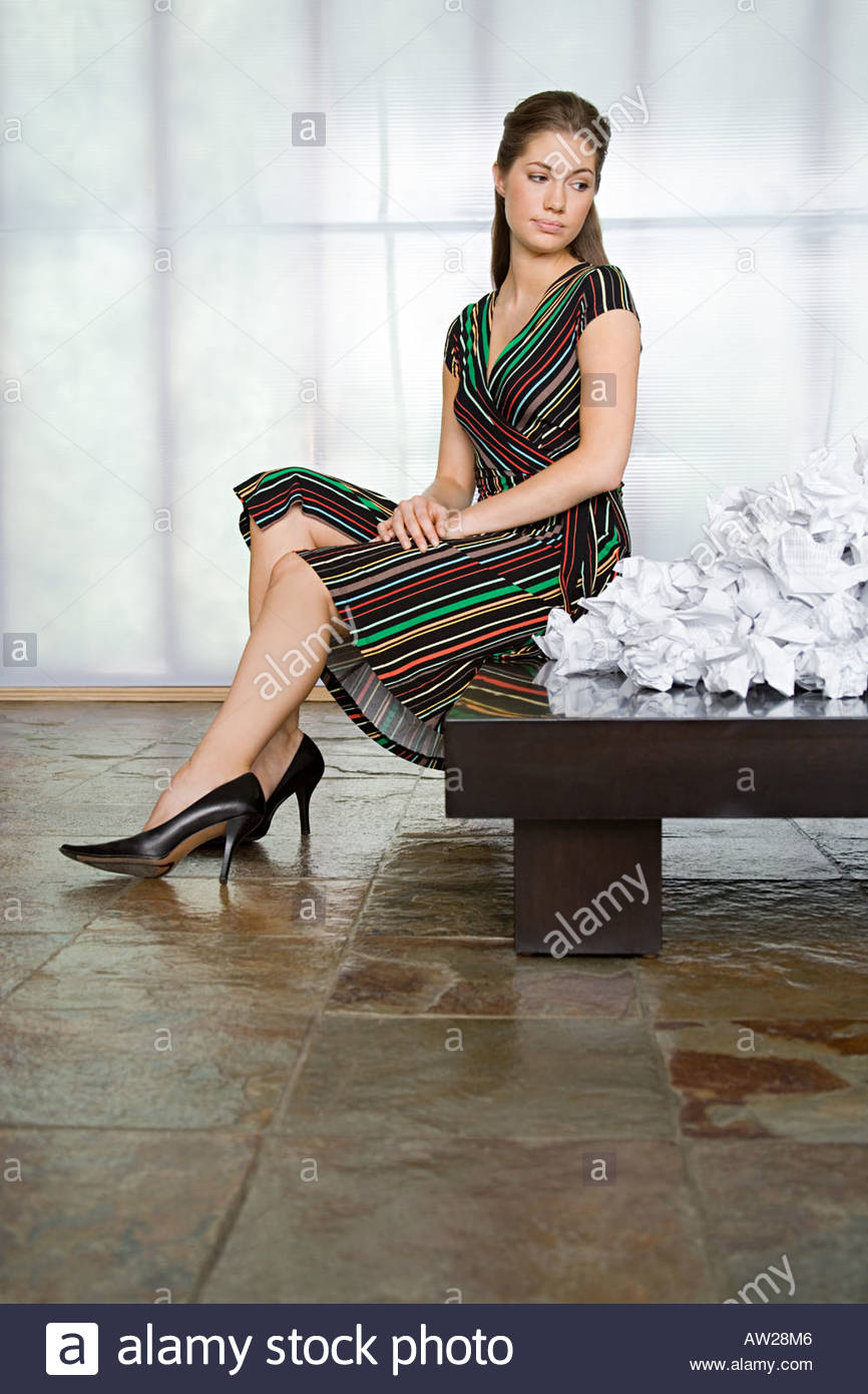 Businesswoman looking at crumpled paper - Stock Image