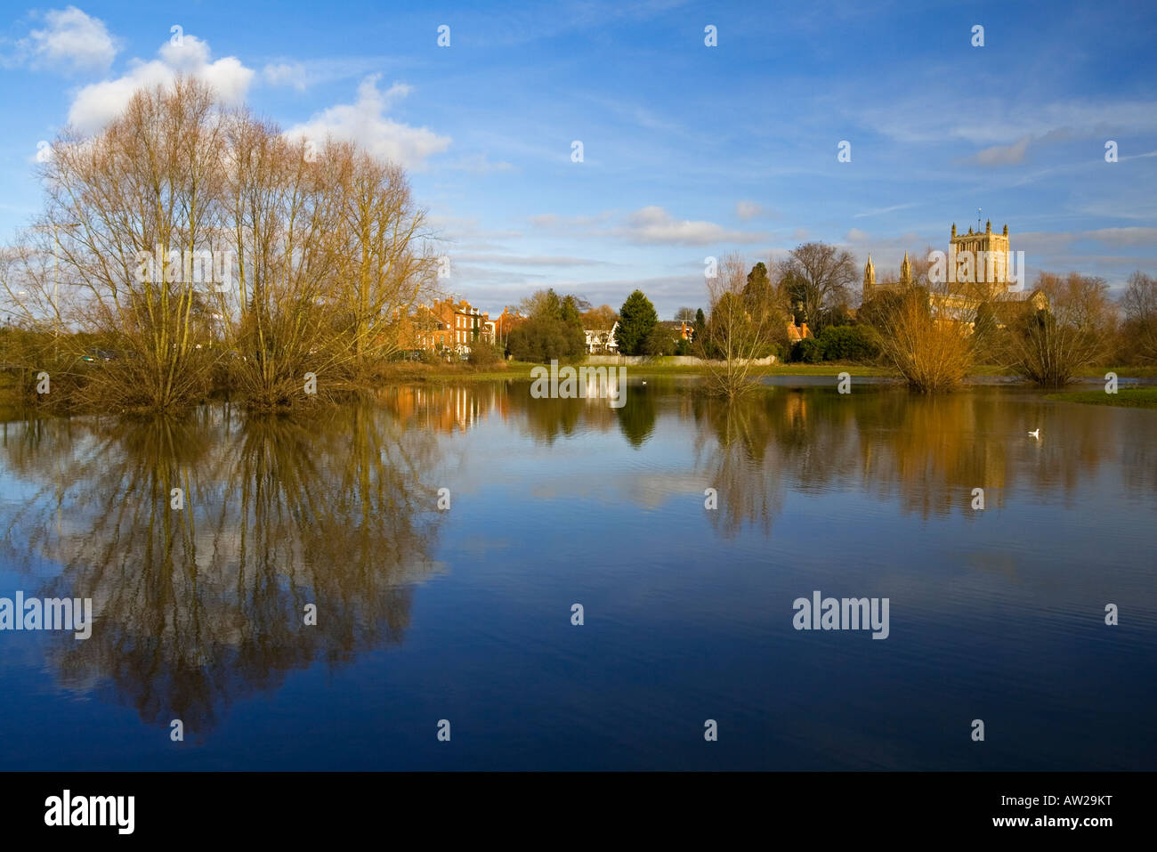 Tewkesbury Abbey St Mary the Virgin Church Gloucestershire England UK with tower reflected in flood water in foreground - Stock Image