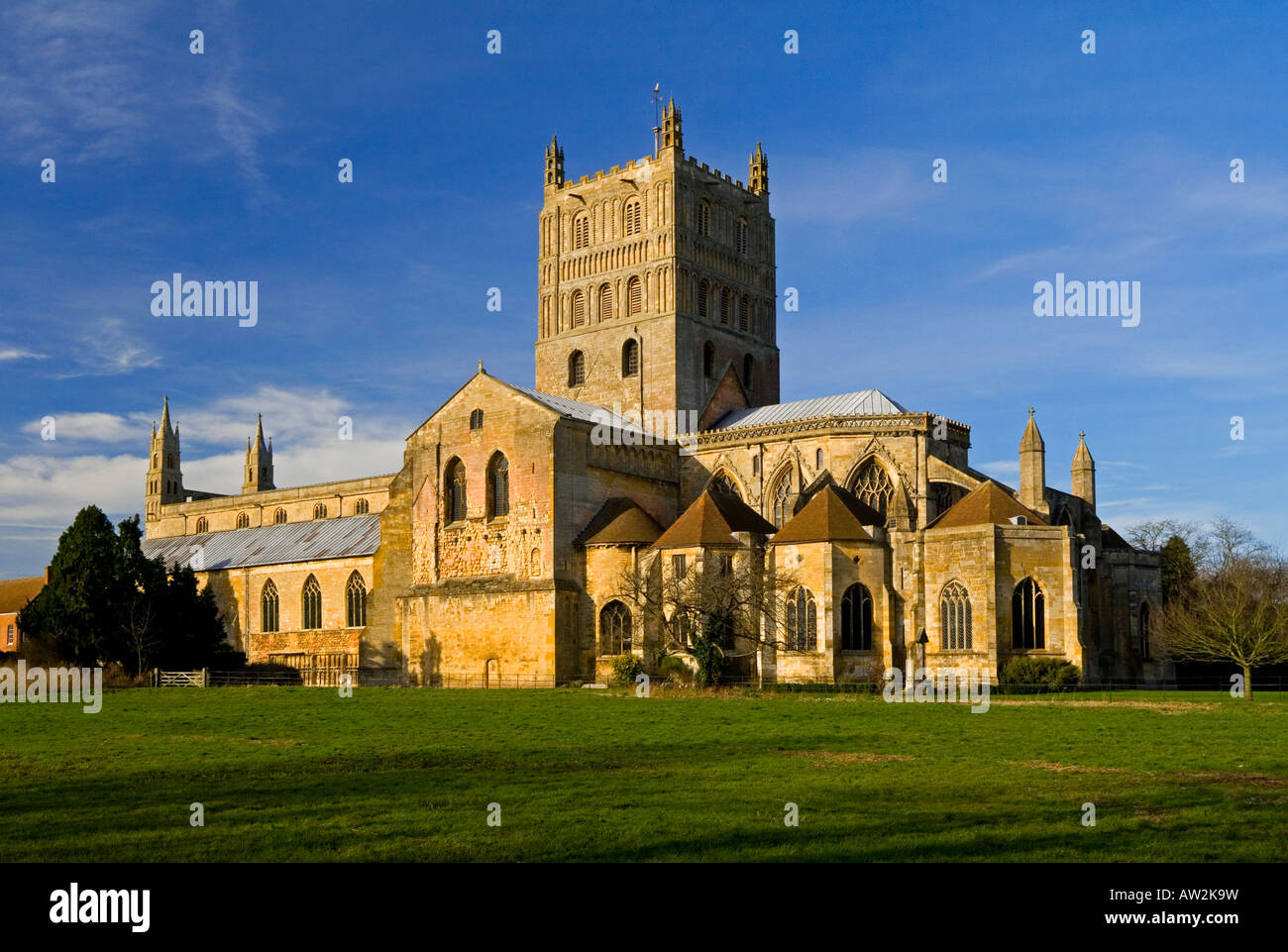 Tewkesbury Abbey St Mary the Virgin Church Gloucestershire England UK with tower and blue sky - Stock Image