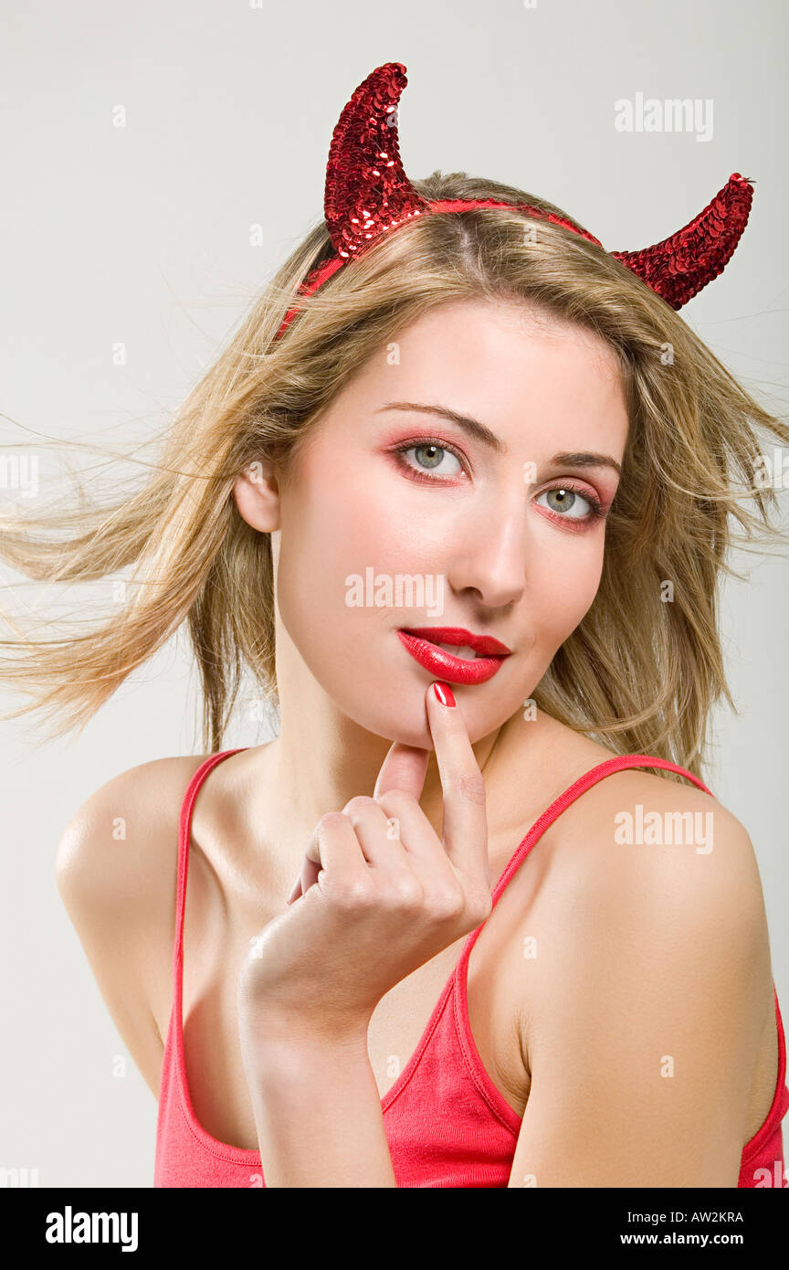 Woman wearing a devil costume - Stock Image
