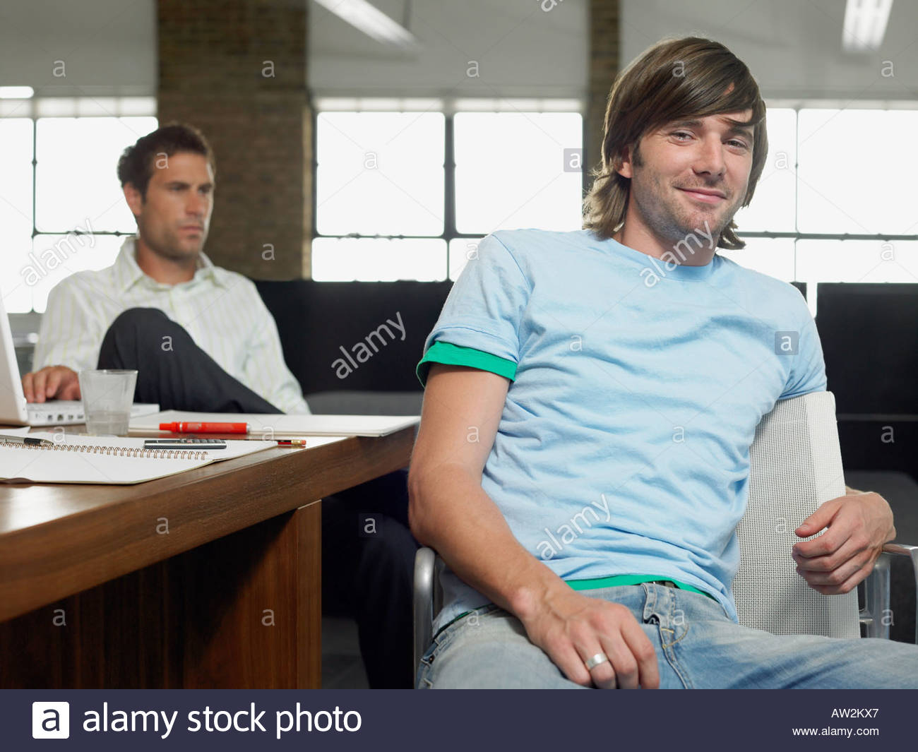 Two male media workers - Stock Image