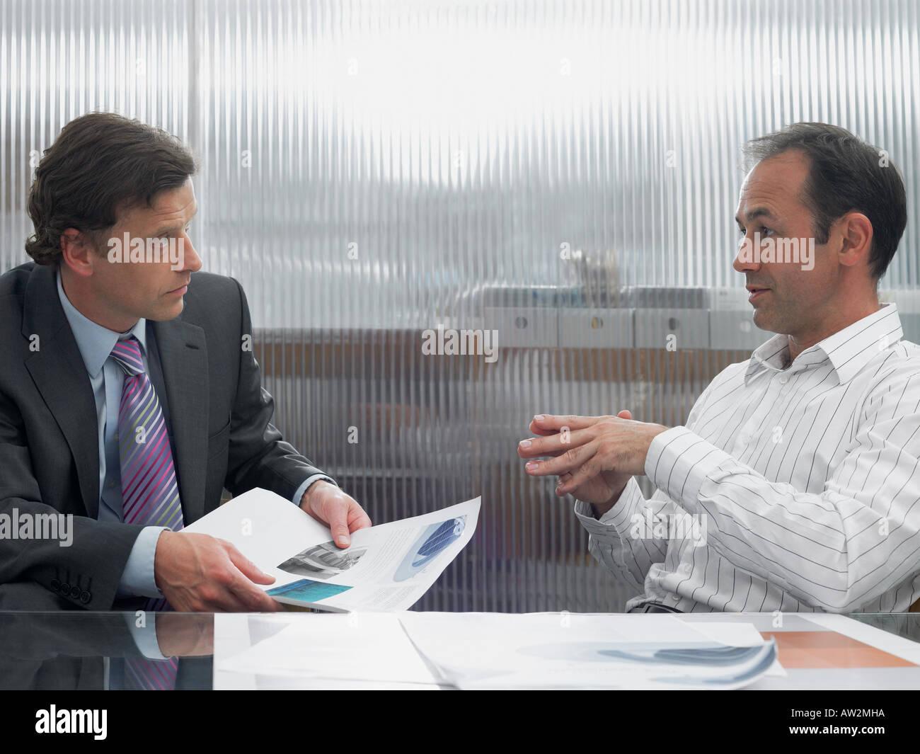 Buisnessmen in discussion - Stock Image