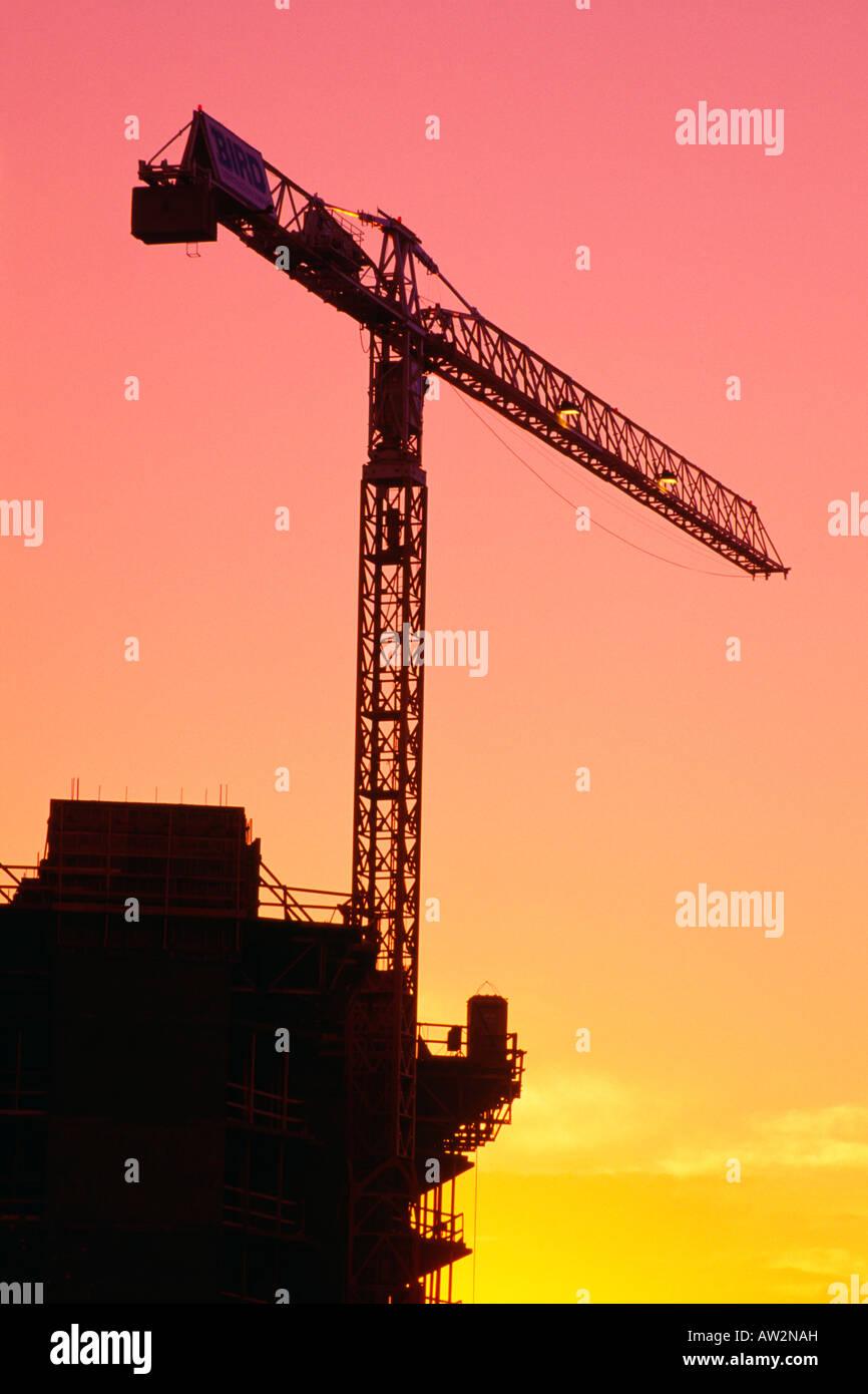 Silhouette of construction crane - Stock Image