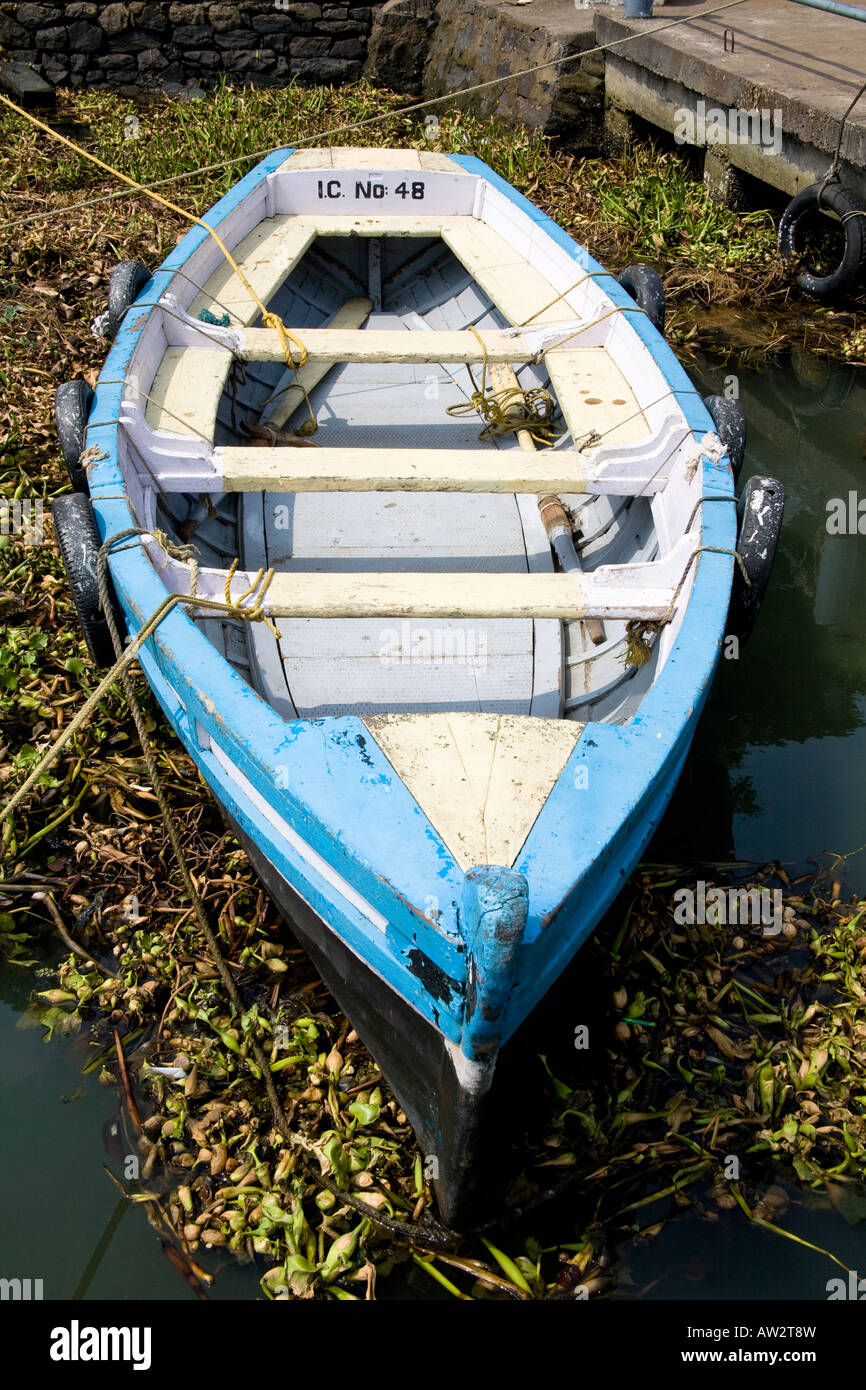 Blue and white rowing boat moored at Mattancherry Jetty, Mattancherry, Cochin, Kerala, India - Stock Image