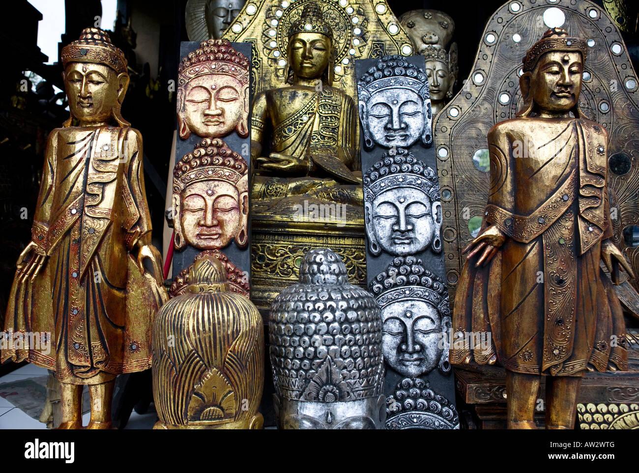 Silver And Gold Buddha Statues Ubud Bali Indonesia - Stock Image