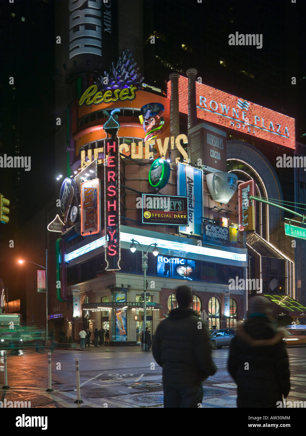 Hersheys advertisements 48th Street and Broadway, near Times Square, Manhattan New York USA at night - Stock Image