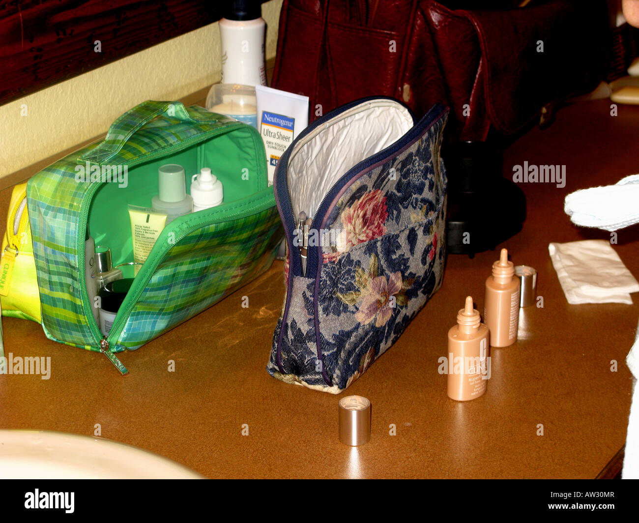 Travel bags full of cosmetics and toiletries. - Stock Image