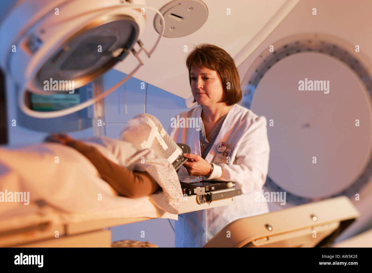 Patient being readied for Linear Accelerator radiation therapy - Stock Image