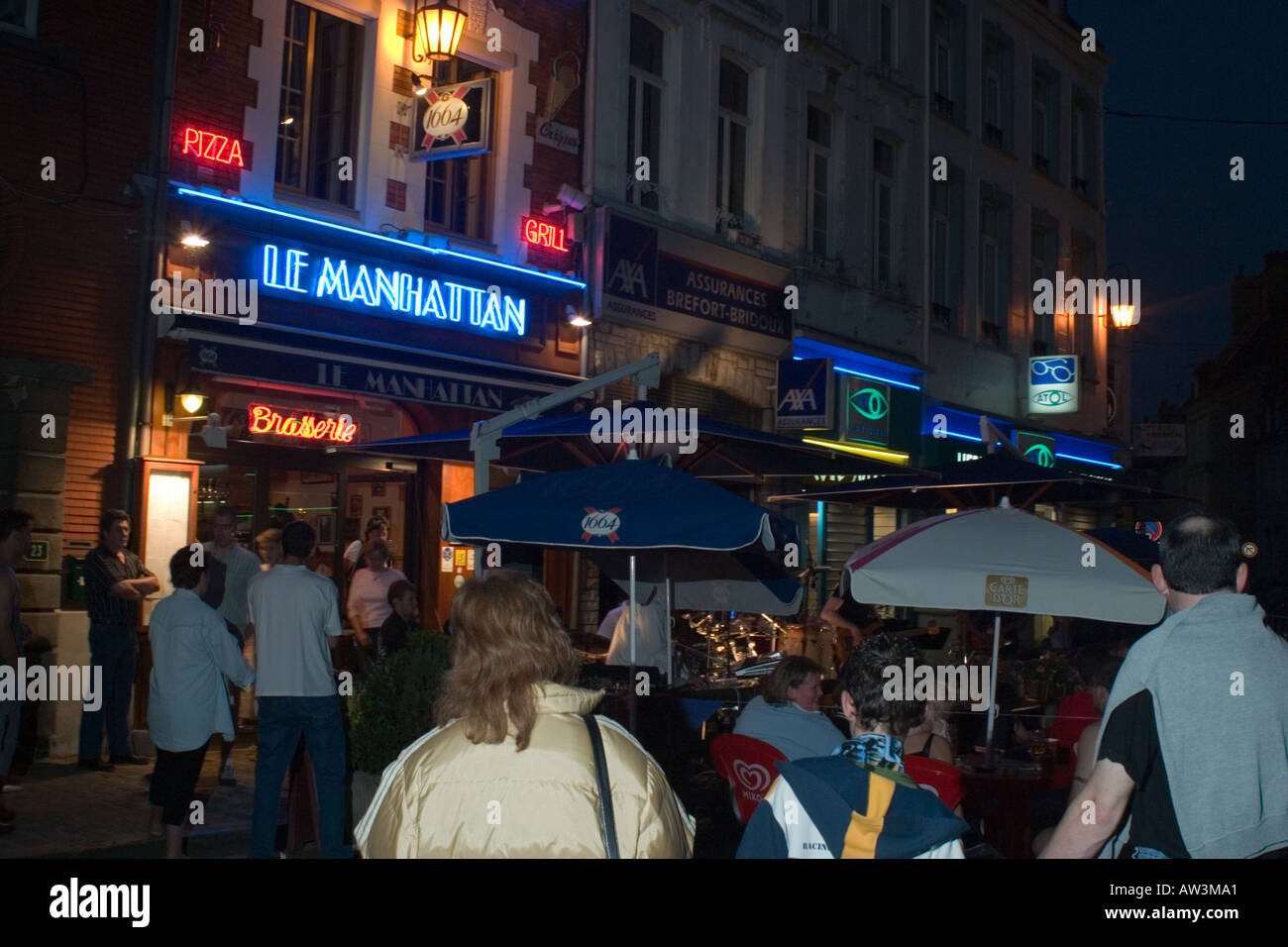 General view along town square during the Fete de la Musique event Hesdin at night - Stock Image