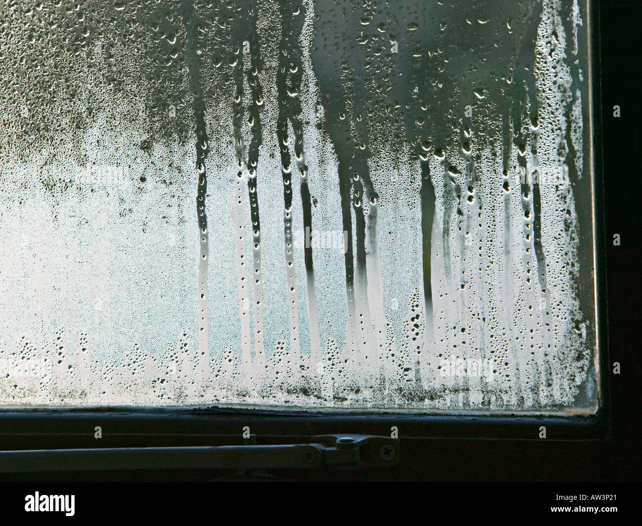 Condensation on double glazed window in house Wales UK - Stock Image
