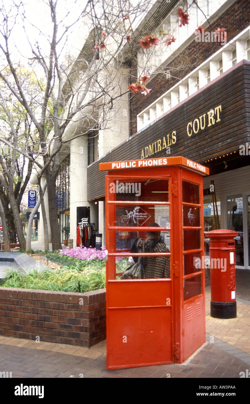 Telephone kiosk and historic British Post Box Rosebank shopping mall Johannesburg South Africa - Stock Image