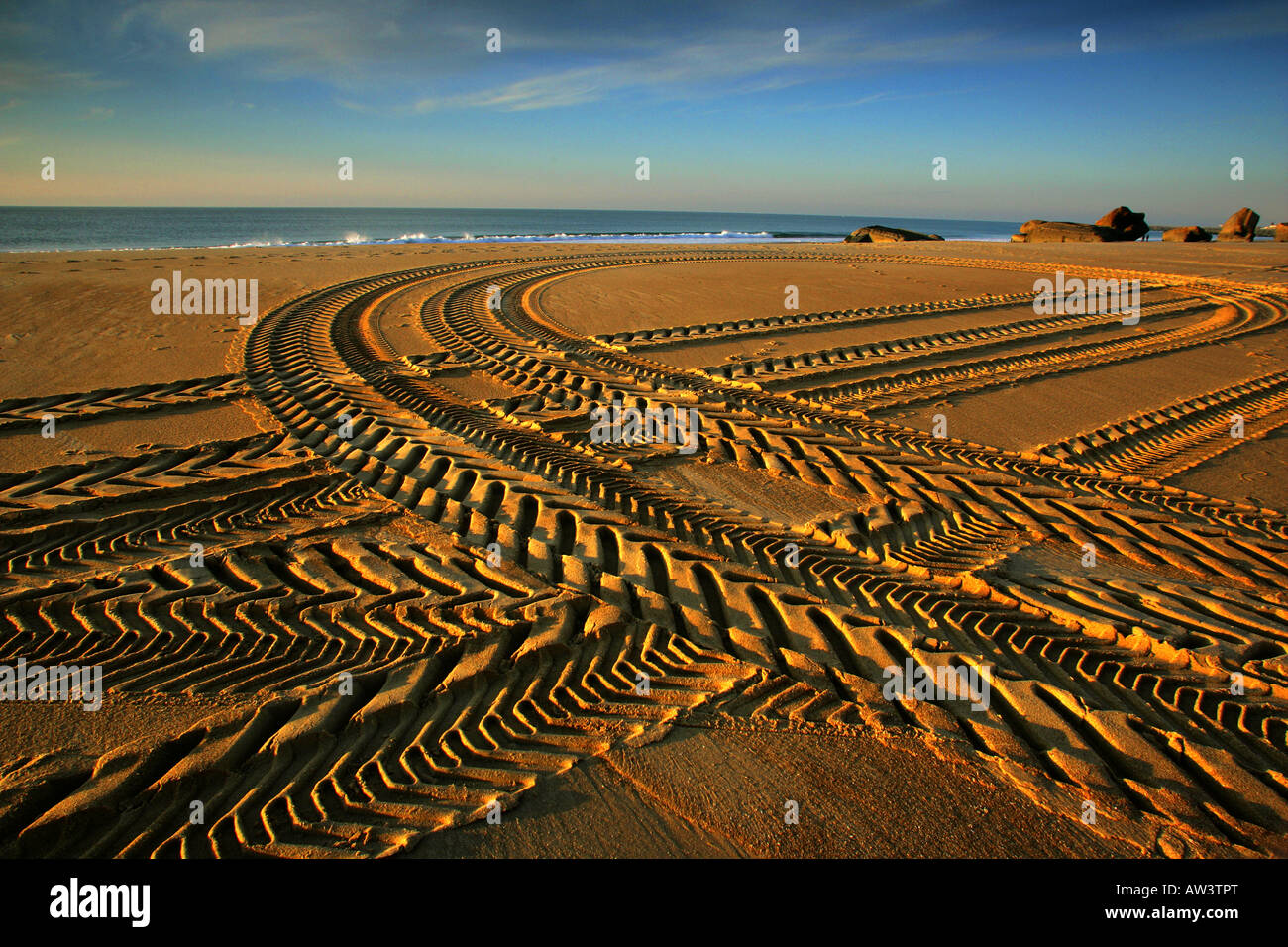 Tyre tracks in the sand at Capbreton in France. - Stock Image