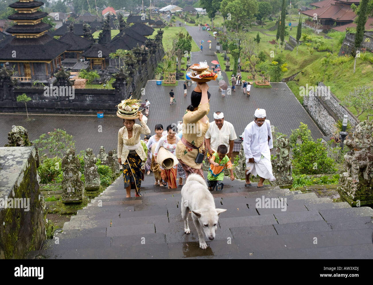 A Balinese Funeral Procession Carrying Umbrellas Climbing The Steps Up To The Pura Besakih Temple Bali Indonesia - Stock Image