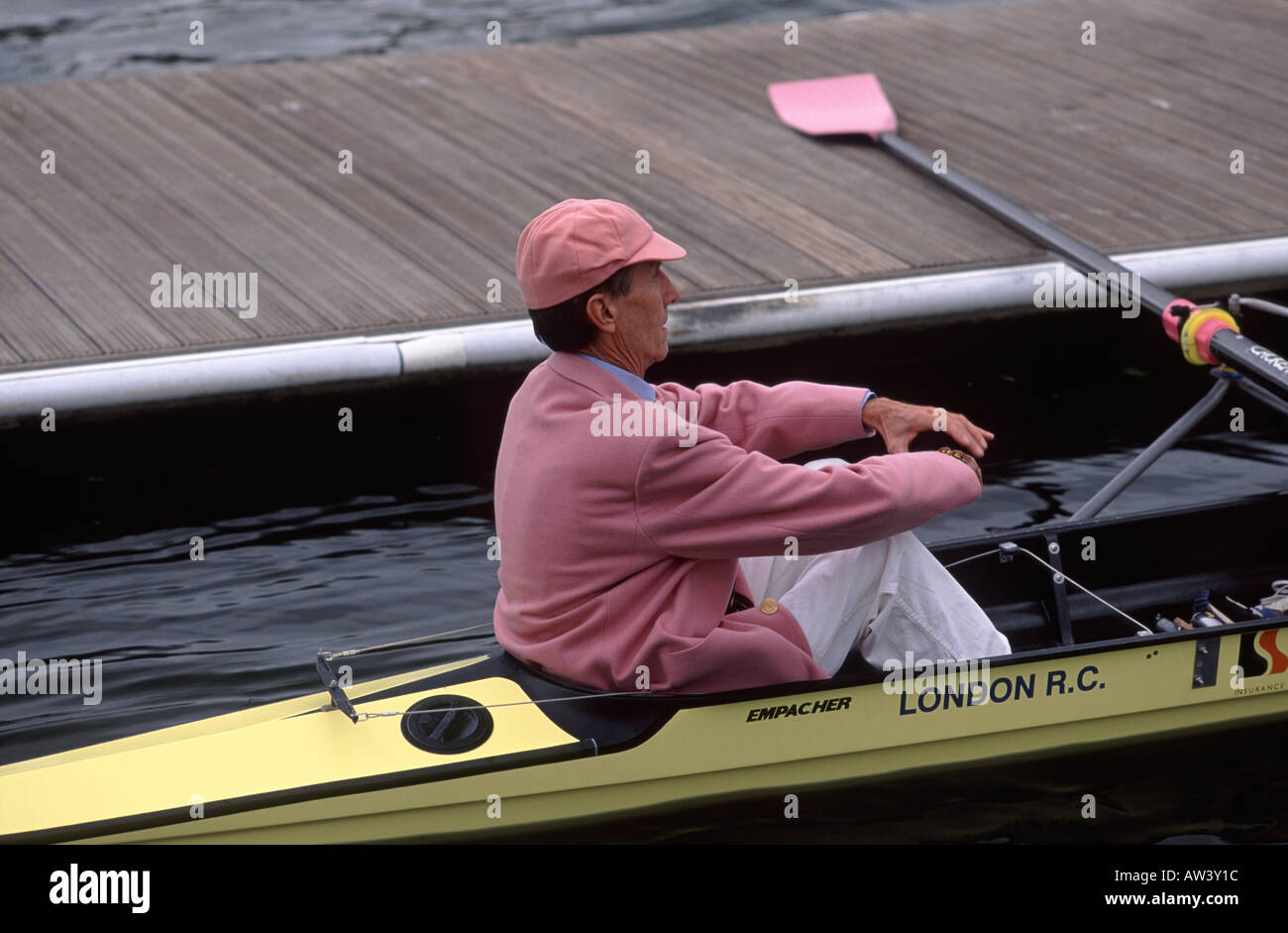 Cox of the Leander Club sitting in stern of rowing boat at Henley Royal Regatta, Henley, River Thames, Oxfordshire, Stock Photo