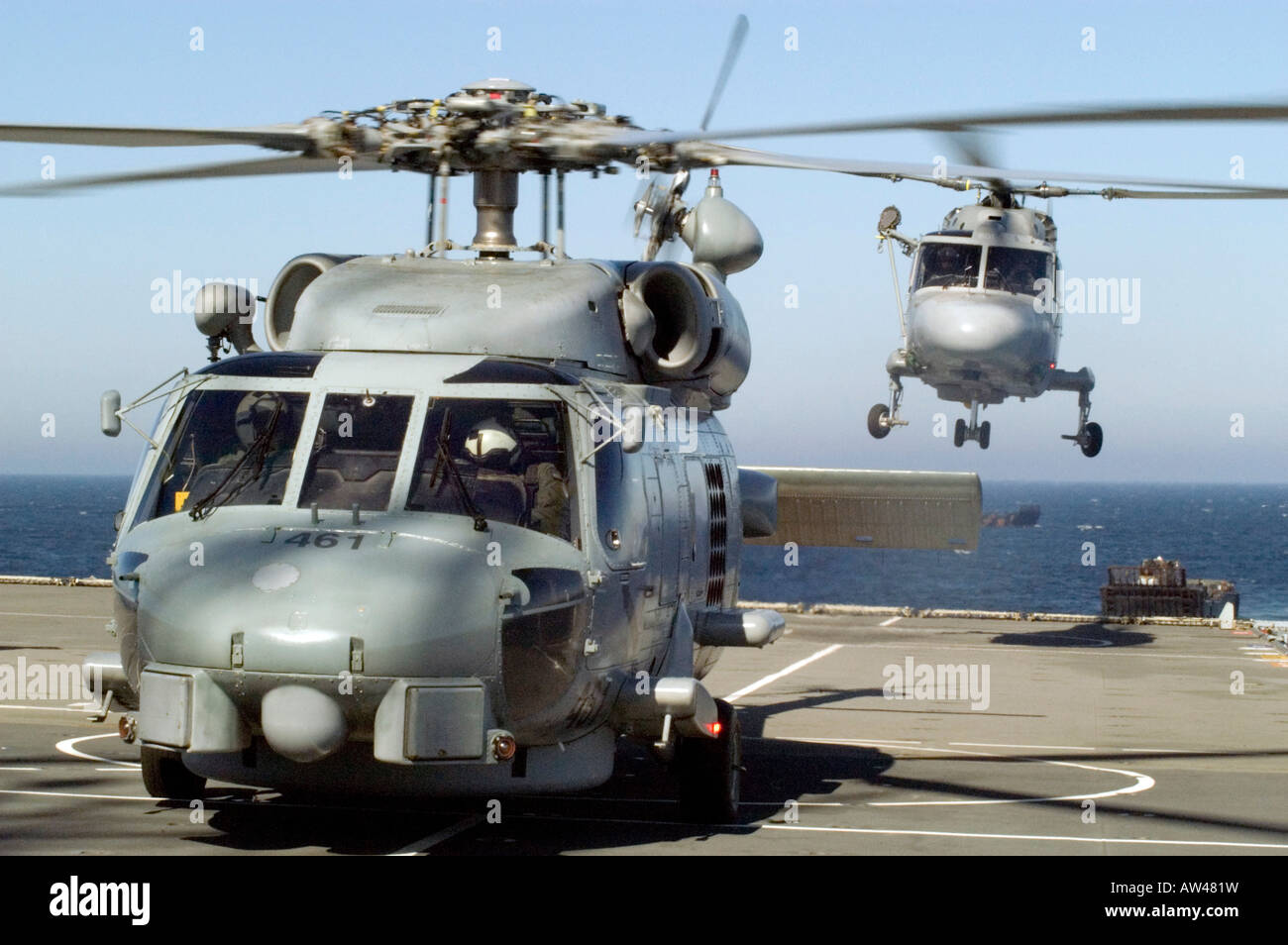 Nato Cooperation A US Navy Seahawk Helicopter On The Deck Of UK HMS Albion While French Lynx Landing
