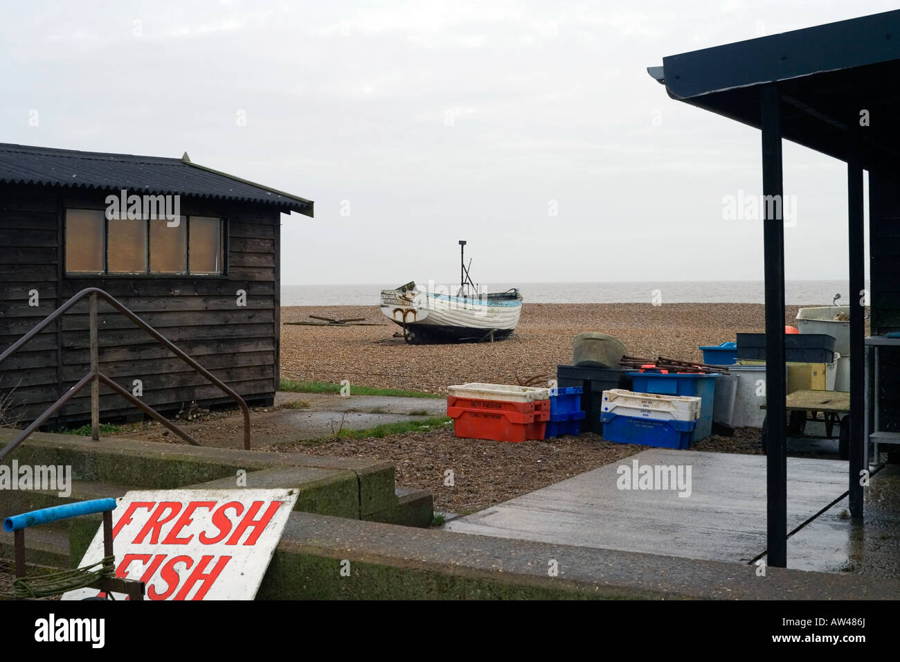 Aldeburgh Fisherman Shops Backyard and Boat - Stock Image