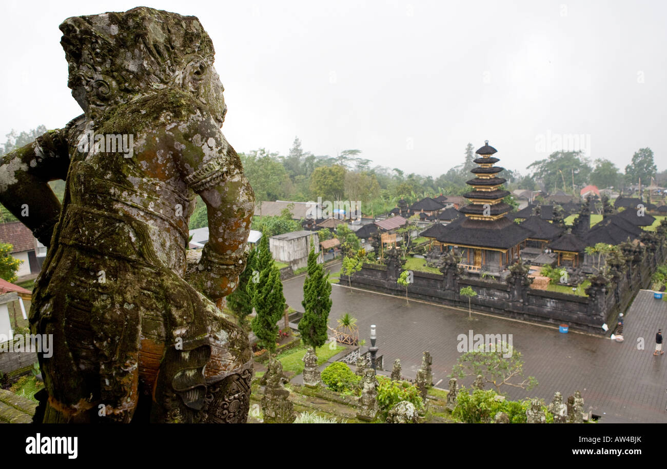Stone Carvings Overlooking  The Pura Besakih Temple Bali Indonesia - Stock Image