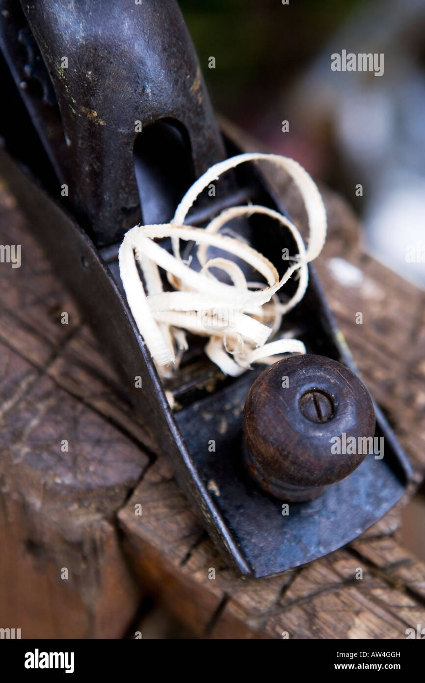 Still life of an old woodwork plane with wood shavings - Stock Image