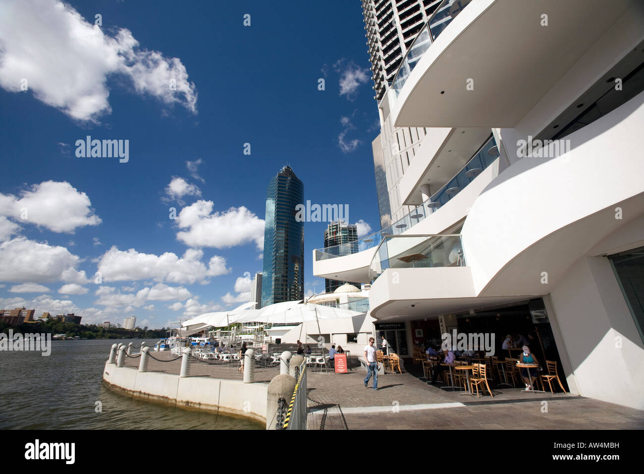 brisbane's riverside promenade with office buildings,cafe and brisbane river - Stock Image
