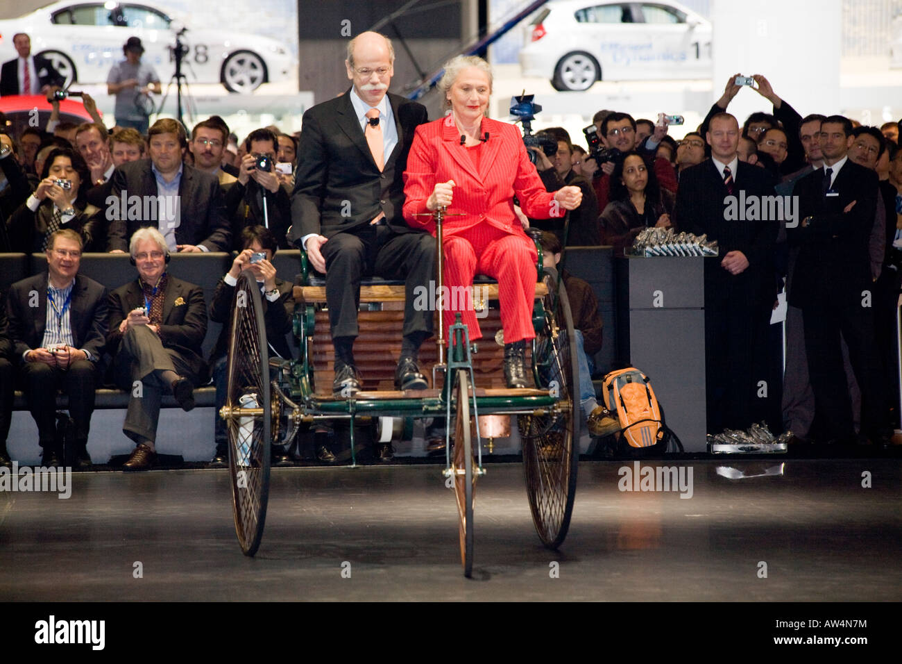 Daimler CEO Dieter Zetsche at a Motor Show, world's oldest car, driven by the founder's descendant, Jutta - Stock Image