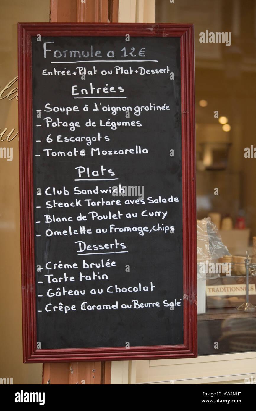 Menu board outside a brasserie in Paris France - Stock Image