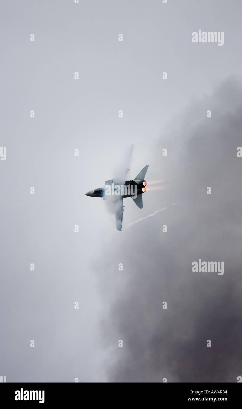 Tornado GR4 fighter jet with vapour trail flying through bomb smoke Stock Photo