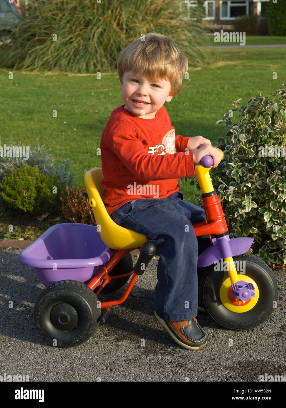 Two Year Old Boy Riding Small Bike In A Drive Stock Photo 16467164