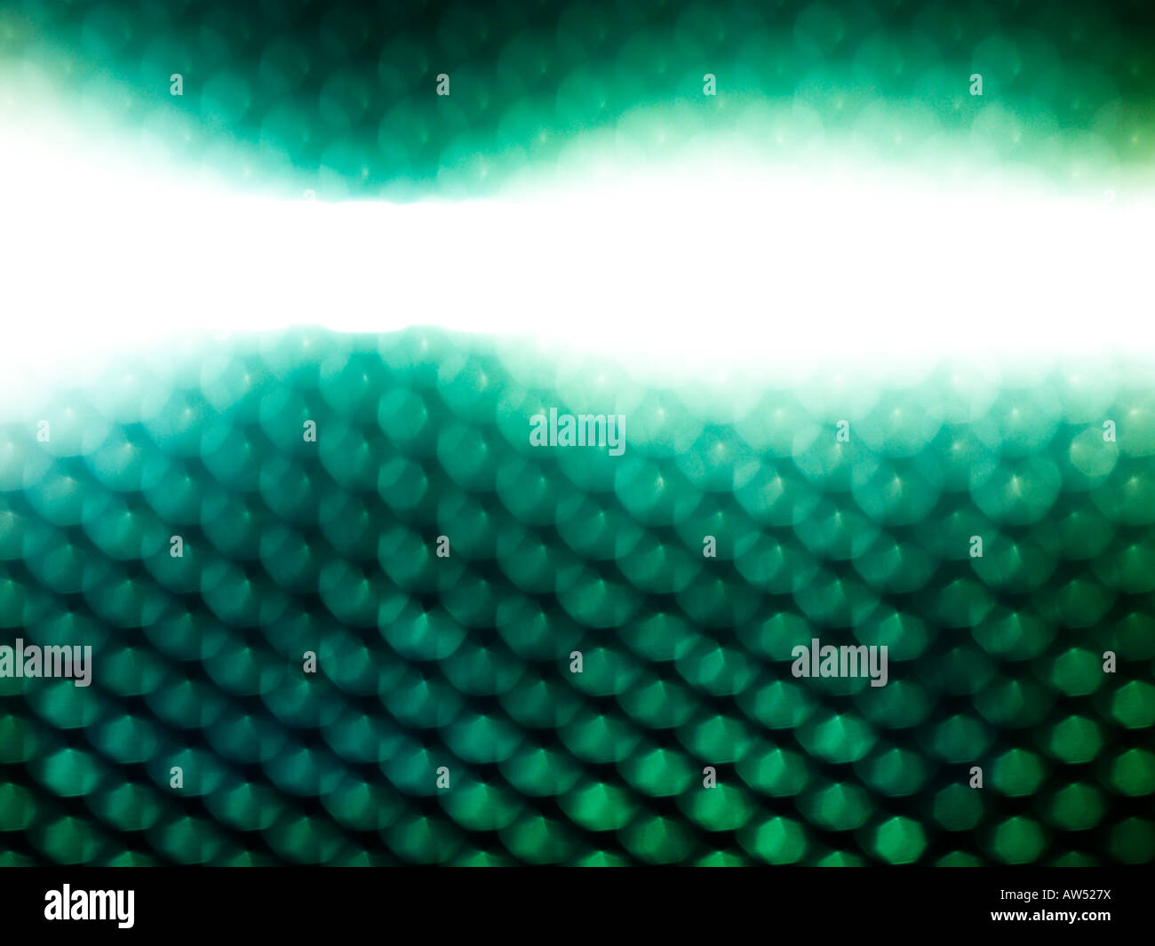 Abstract fine art images Large files size A moving lightsource behing a metal grid - Stock Image