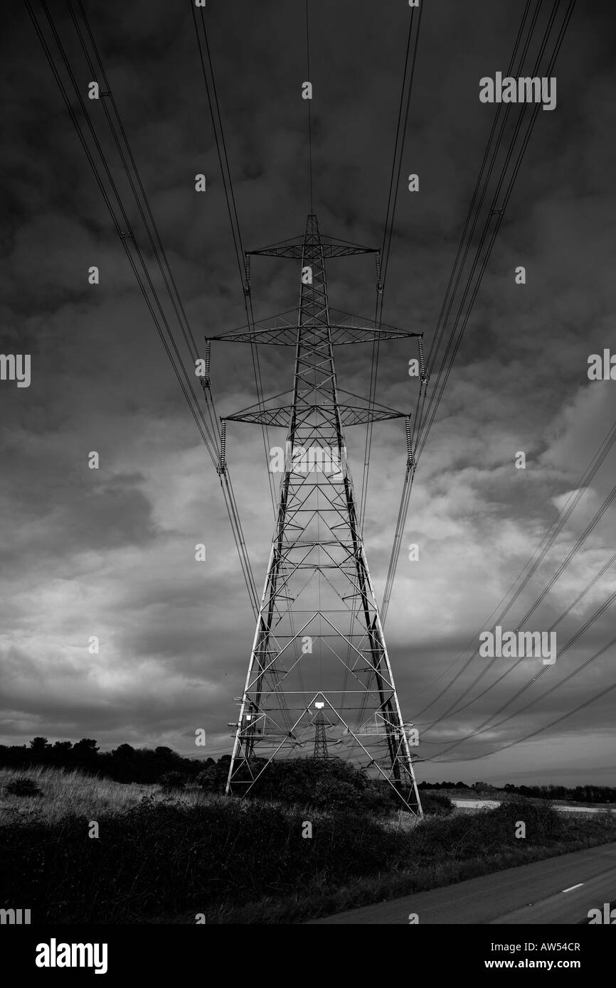Electricity pylons carrying power from the Sizewell B Nuclear Power Station on the Suffolk coast on the east coast - Stock Image