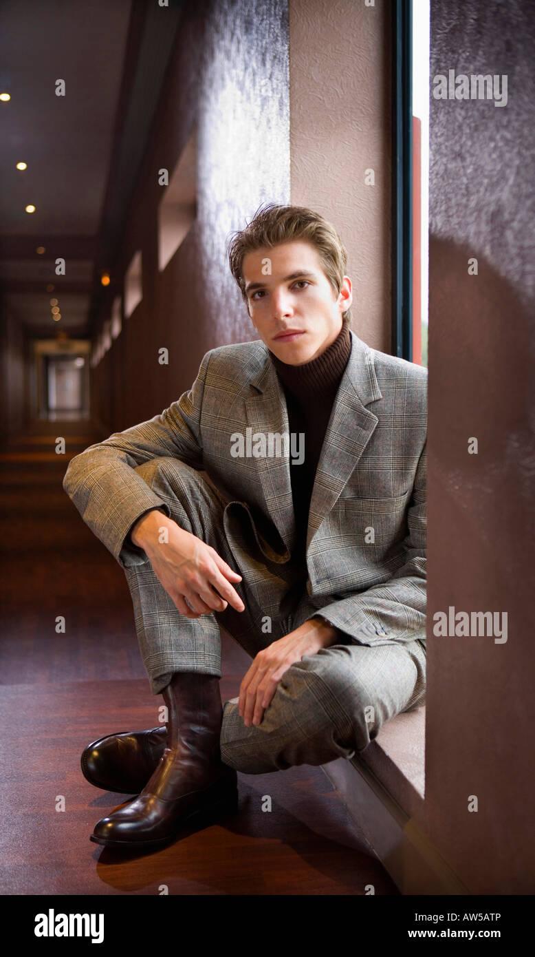 Portrait young businessman sitting. - Stock Image