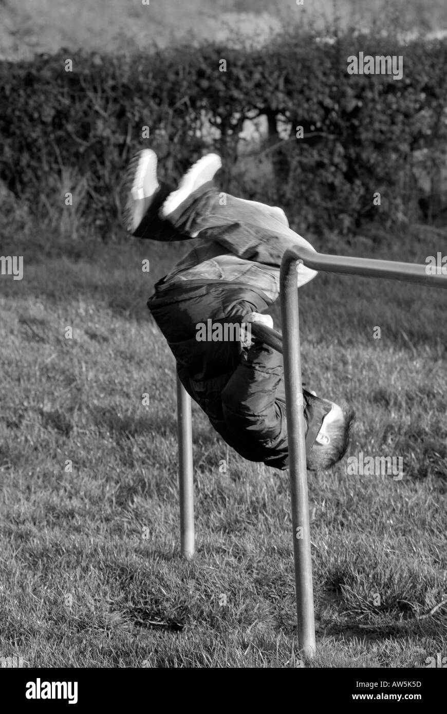 young kid child boy playing on playground equipment climb climbing frame net exercise balance energy hyperactive testosterone ag - Stock Image