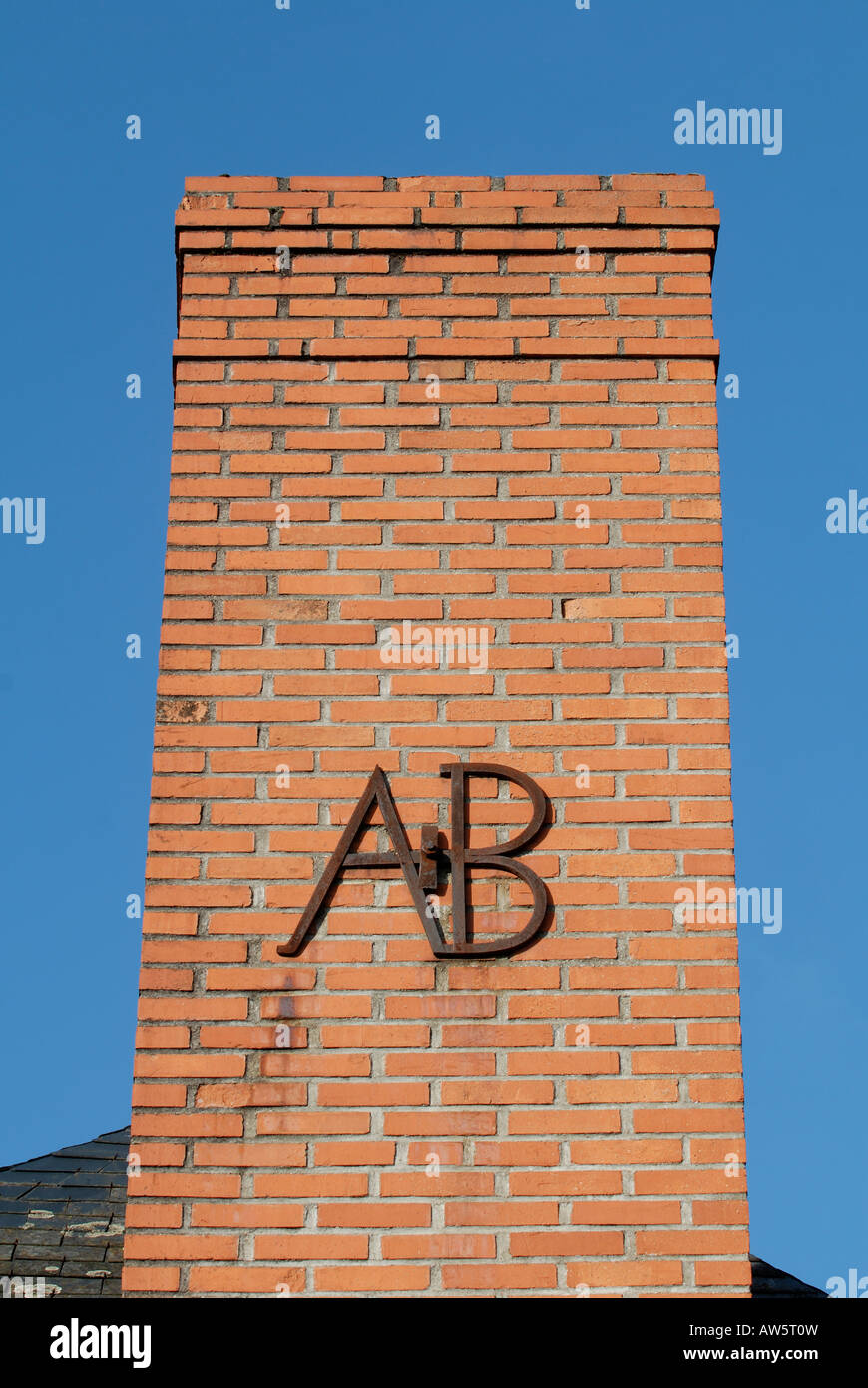 'AB' letters decorating chimney stack, France. - Stock Image