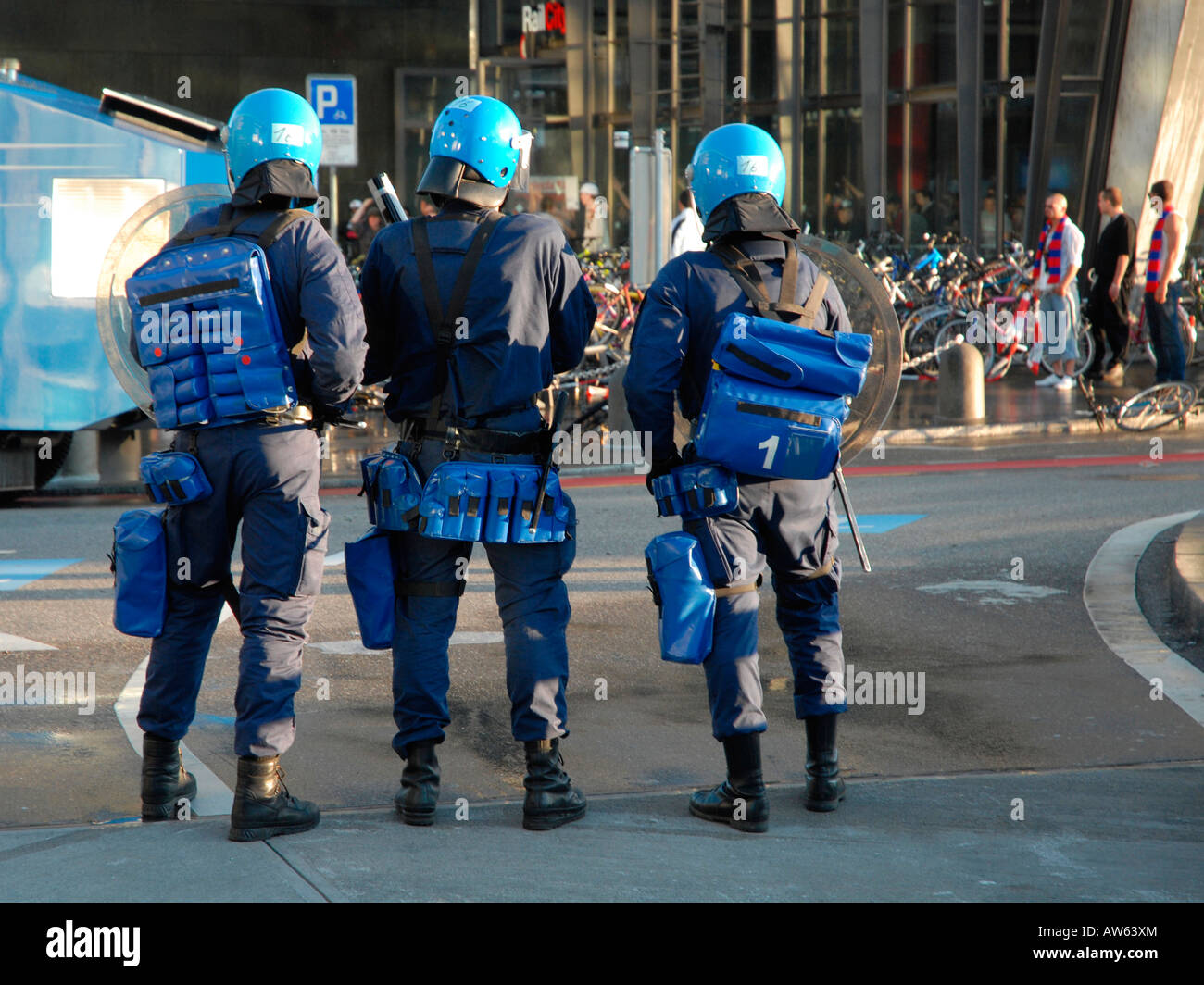 three policeman in front of a group of hooligan - Stock Image