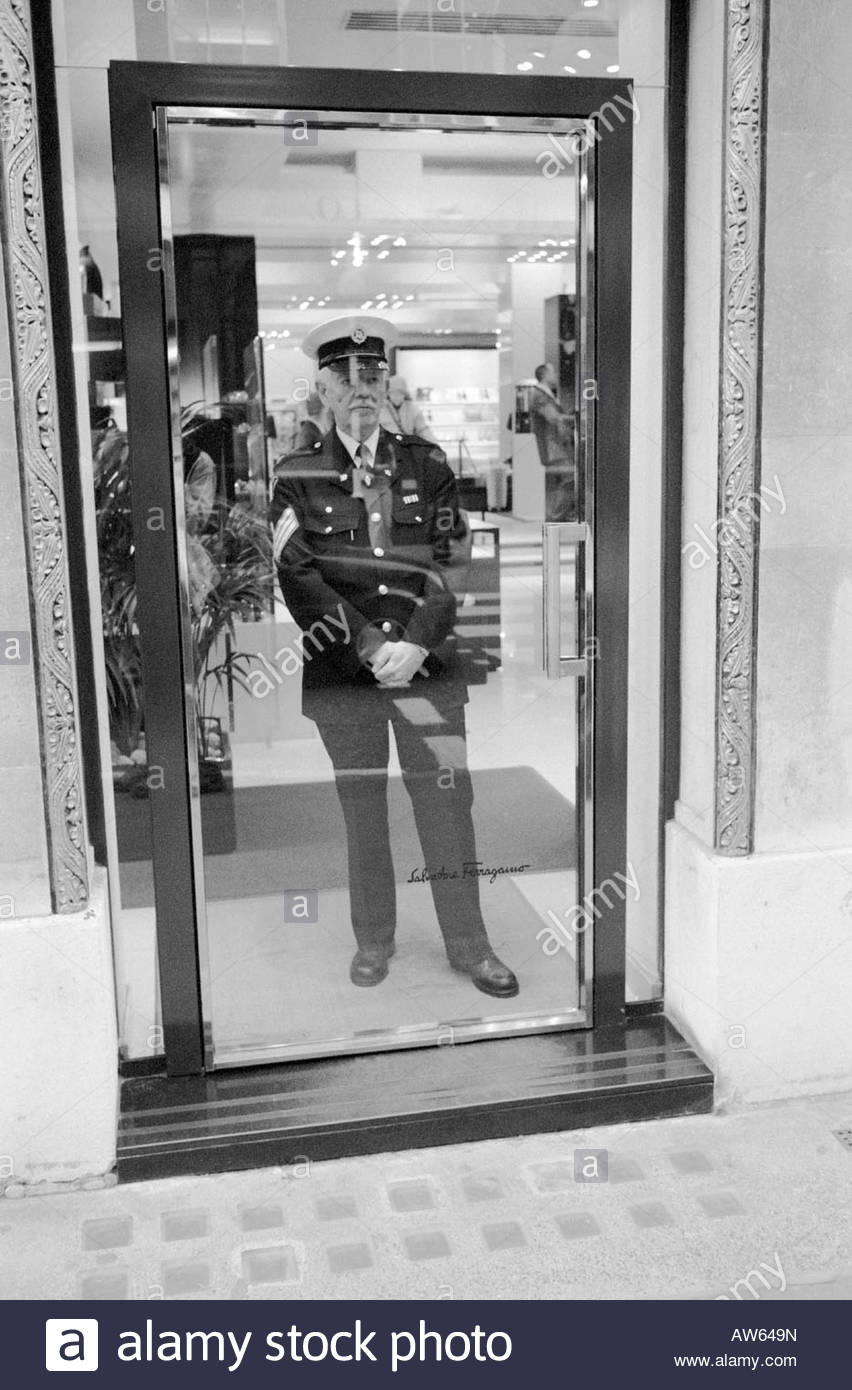 Security guard at Salvatore Ferragamo store on Bond Street London - Stock Image