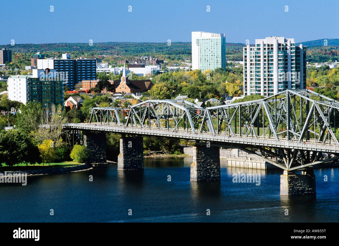 View of Hull and the Alexandra Bridge spanning the Ottawa River, Ottawa, Ontario, Canada - Stock Image