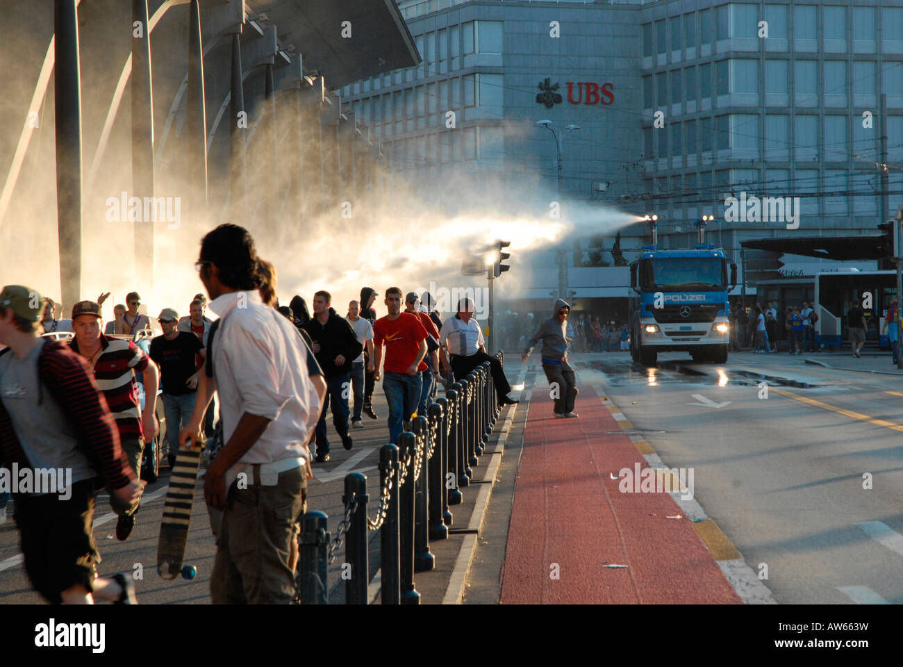 Hooligans an a police car using a water cannon - Stock Image