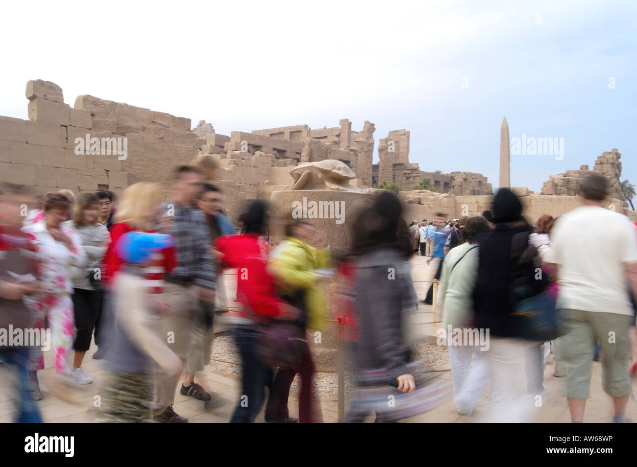 Tourists walk around the Statue of a Scarab Beetle  for good luck  3 x for good luck , 5 x to get married 7 x for - Stock Image