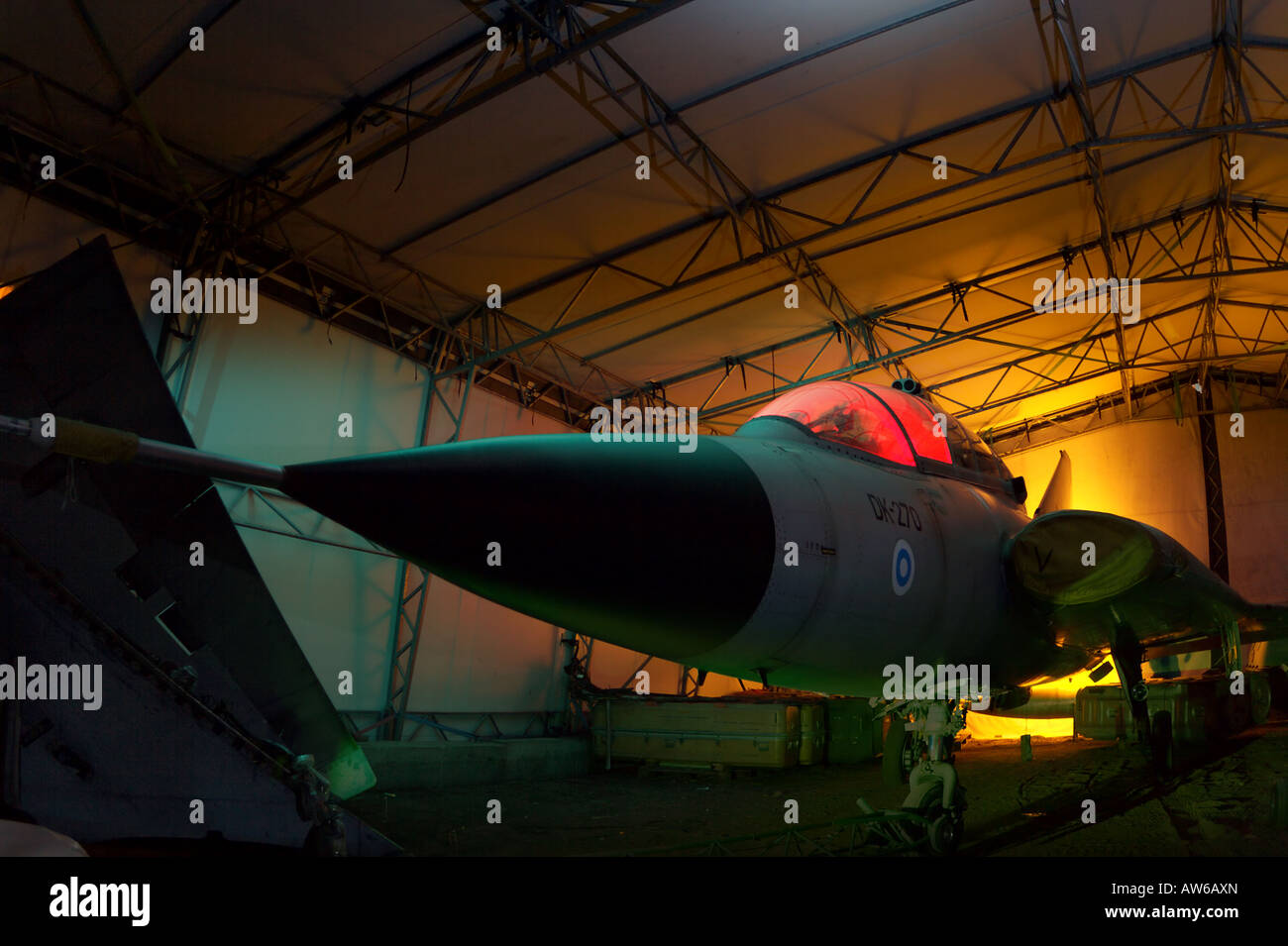 Permanently grounded fighter plane in hangar Stock Photo