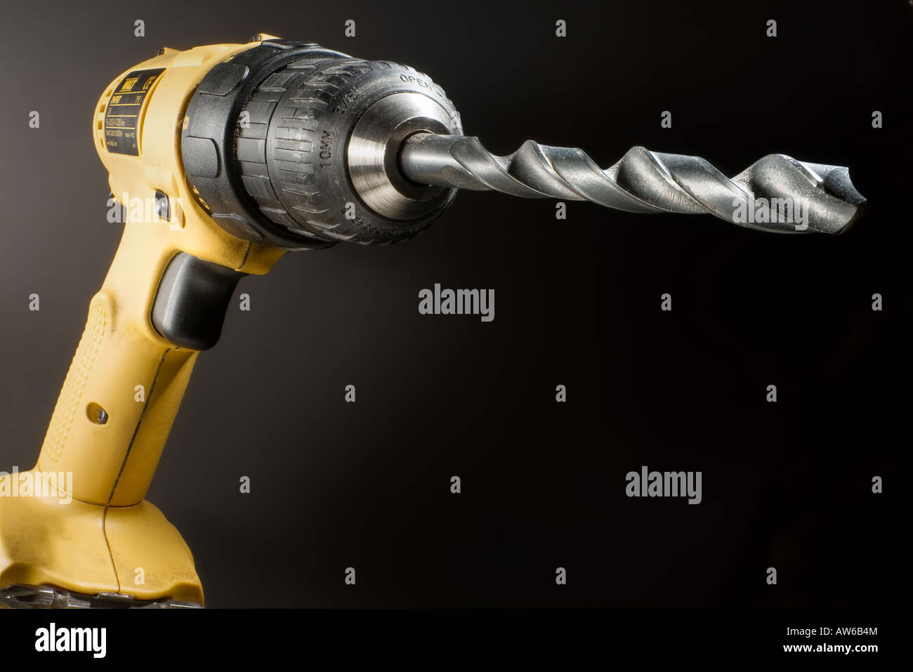 Battery operated hand drill with a drill bit - Stock Image