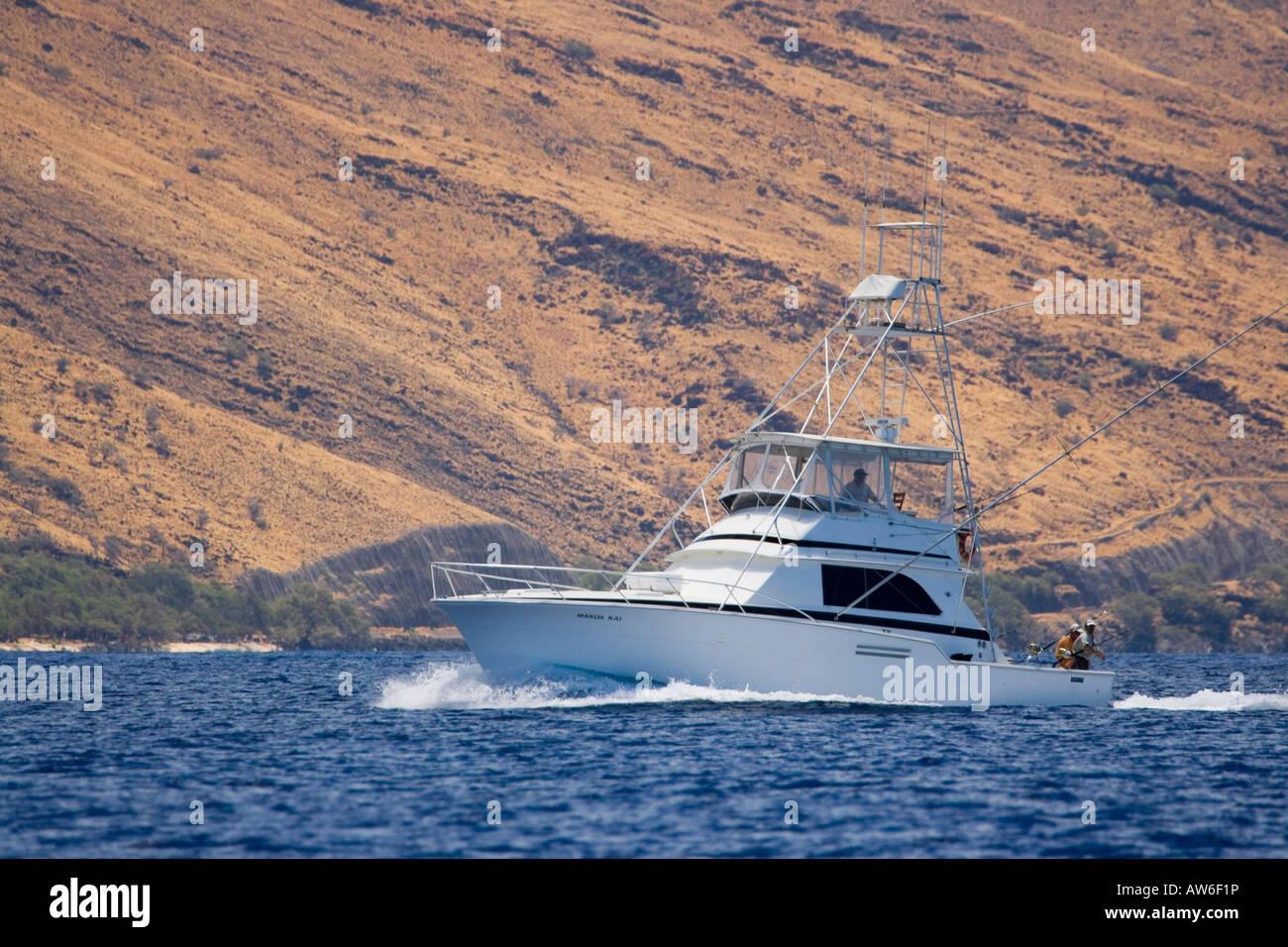 A sportfishing boat cruises the waters off Maui, Hawaii. Stock Photo