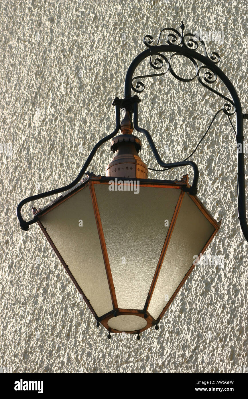 victorian wall mounted opaque glass street lamp - Stock Image