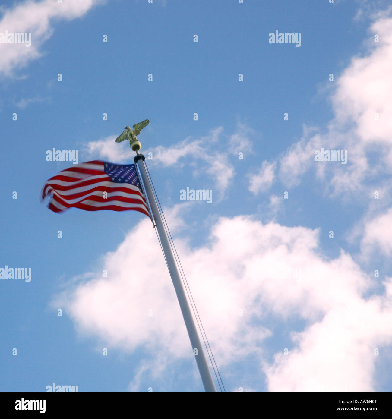 American Flag and Blue Sky - Stock Image