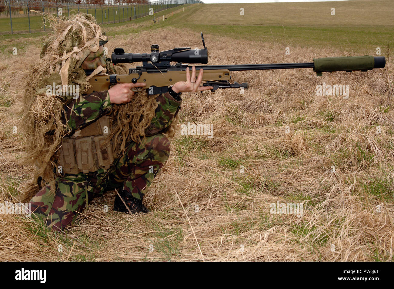 British Infantryman with a long range sniper rifle L115A3 which has a killing capability from over a mile. - Stock Image