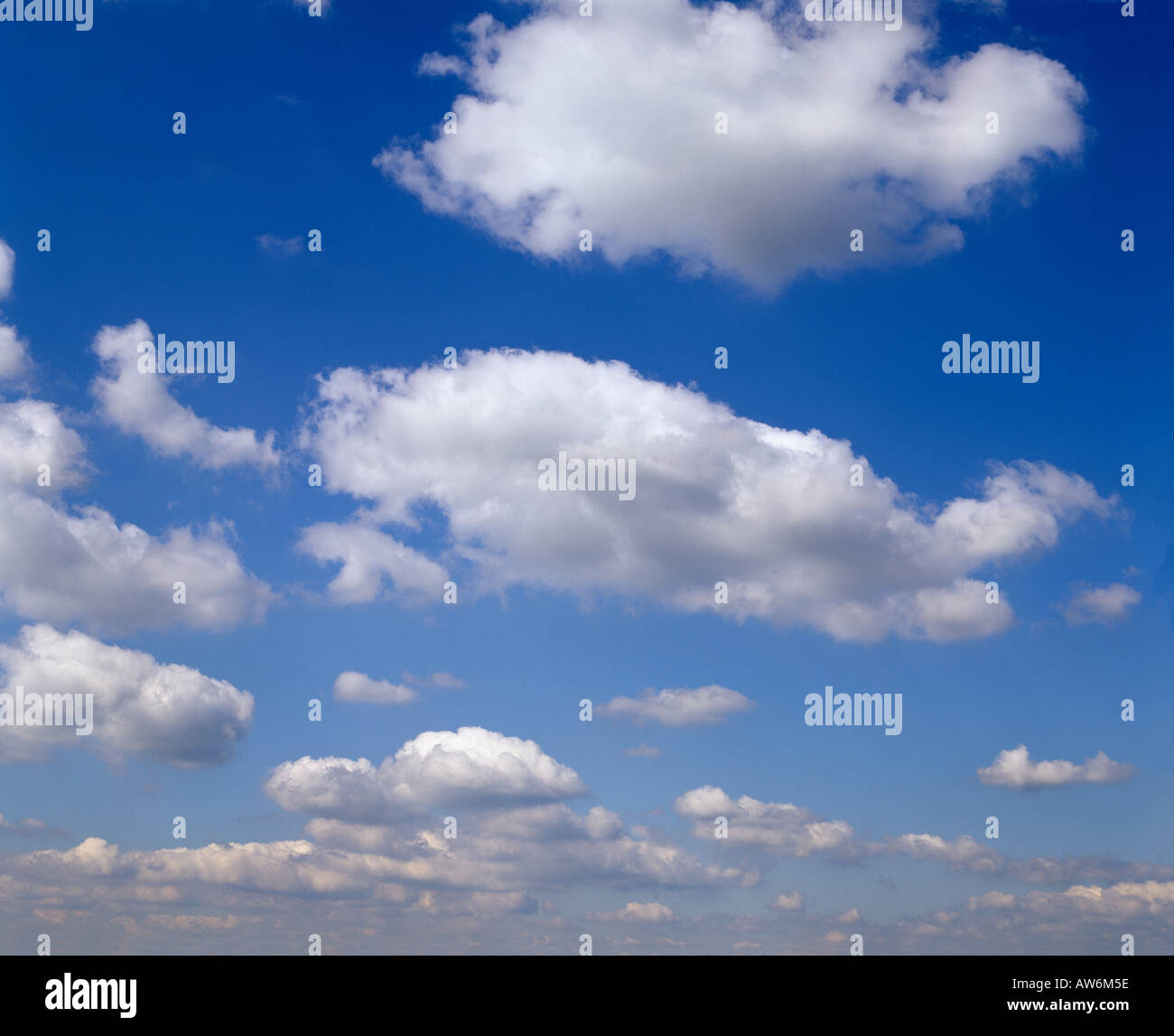 BLUE SKY FLUFFY WHITE CLOUDS HIGH PRESSURE WEATHER SUMMER EUROPE - Stock Image