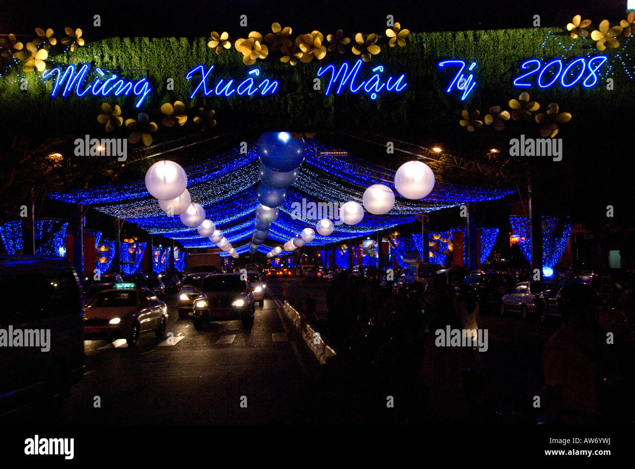 Cars and taxis drive under a canopy of lights during the Tet Lunar New Year celebrations in Ho Chi Minh City Vietnam 2008  sc 1 st  Alamy & Cars and taxis drive under a canopy of lights during the Tet Lunar ...