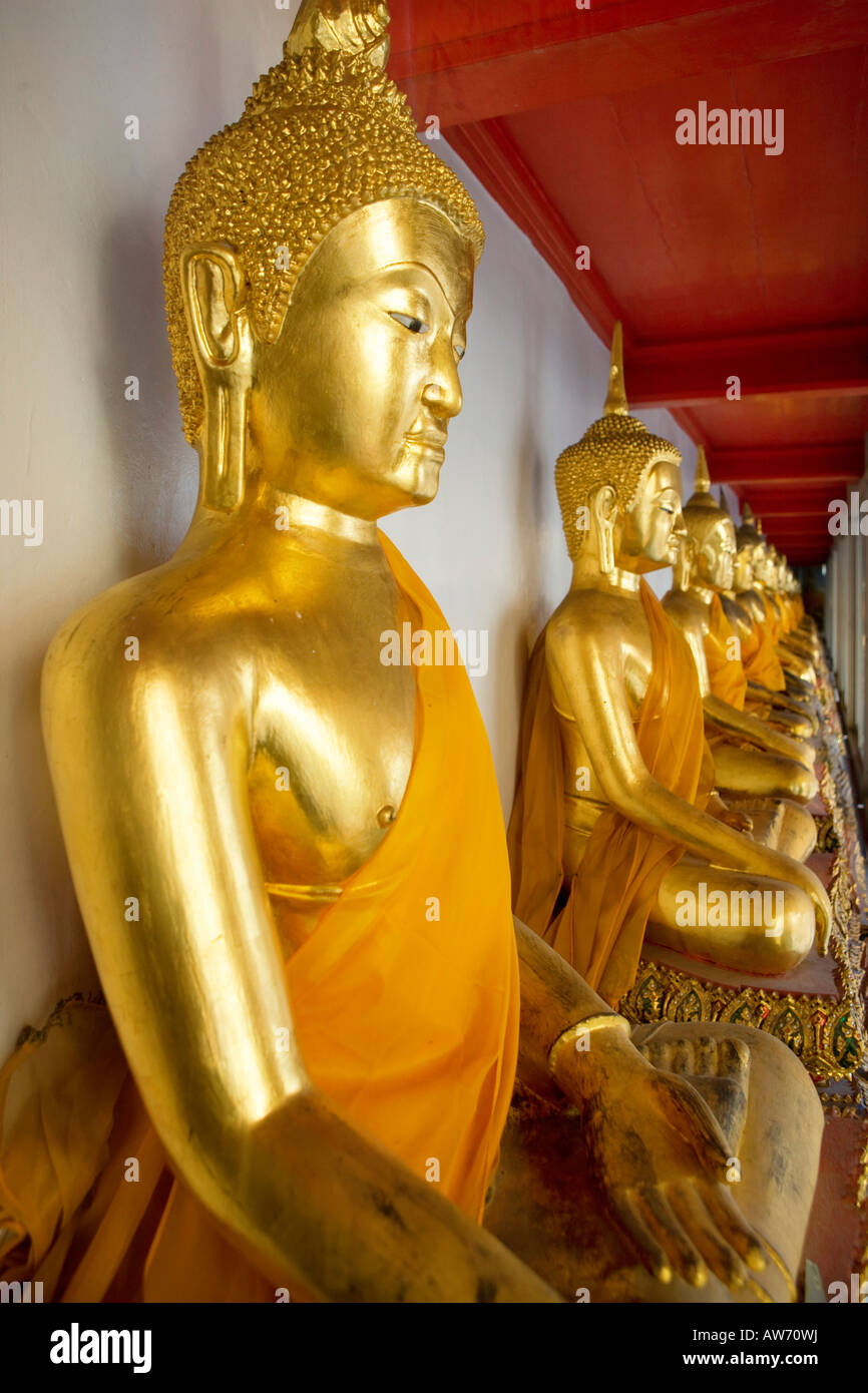 Budhas in the wat pho temple in Bangkok Thailand - Stock Image